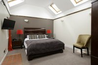 Buchanan Room in adjacent byre with King-size bed, ensuite shower room & fridge